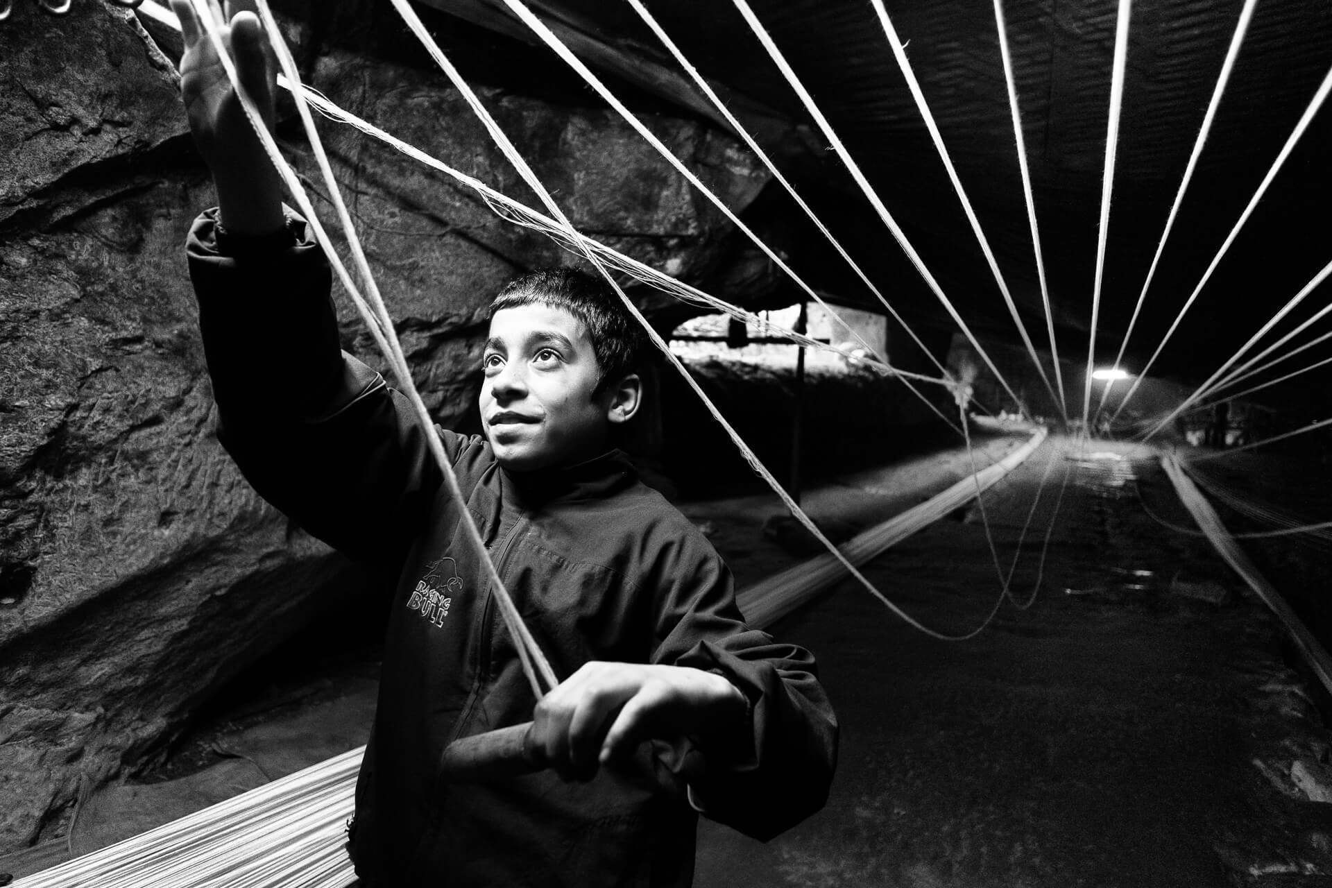 Photo Story, Inside the Caves. Harnessing the Hemp Rope.